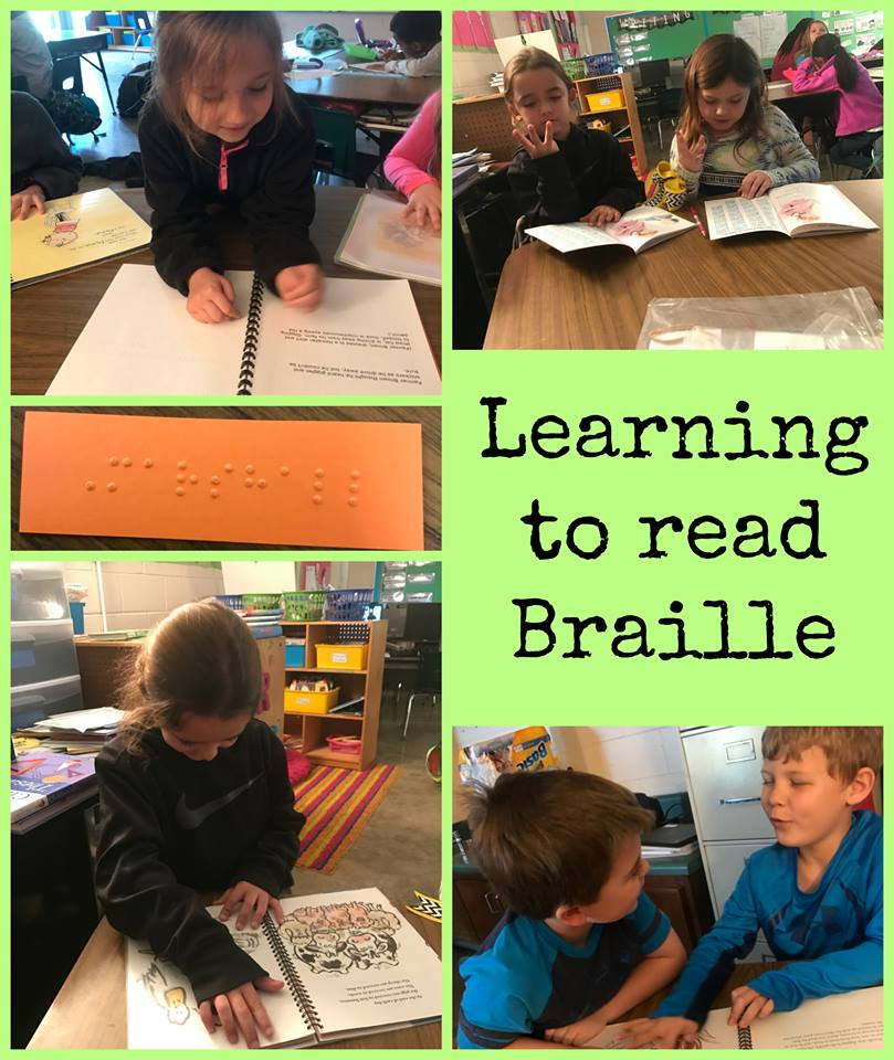 Students learning to read Braille