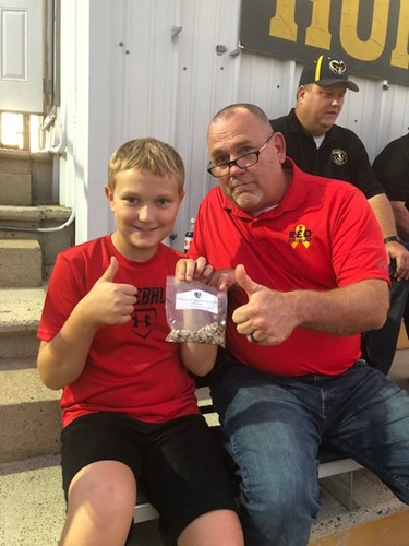 Student and Mr. Settle with WCMS Sunflower seeds