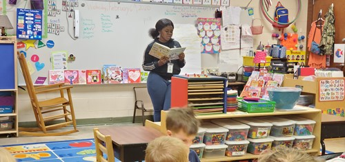 student reading to a class