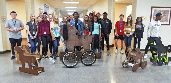 "Mrs. Ford's English classes constructed Trojan horses after reading ""The Iliad."""