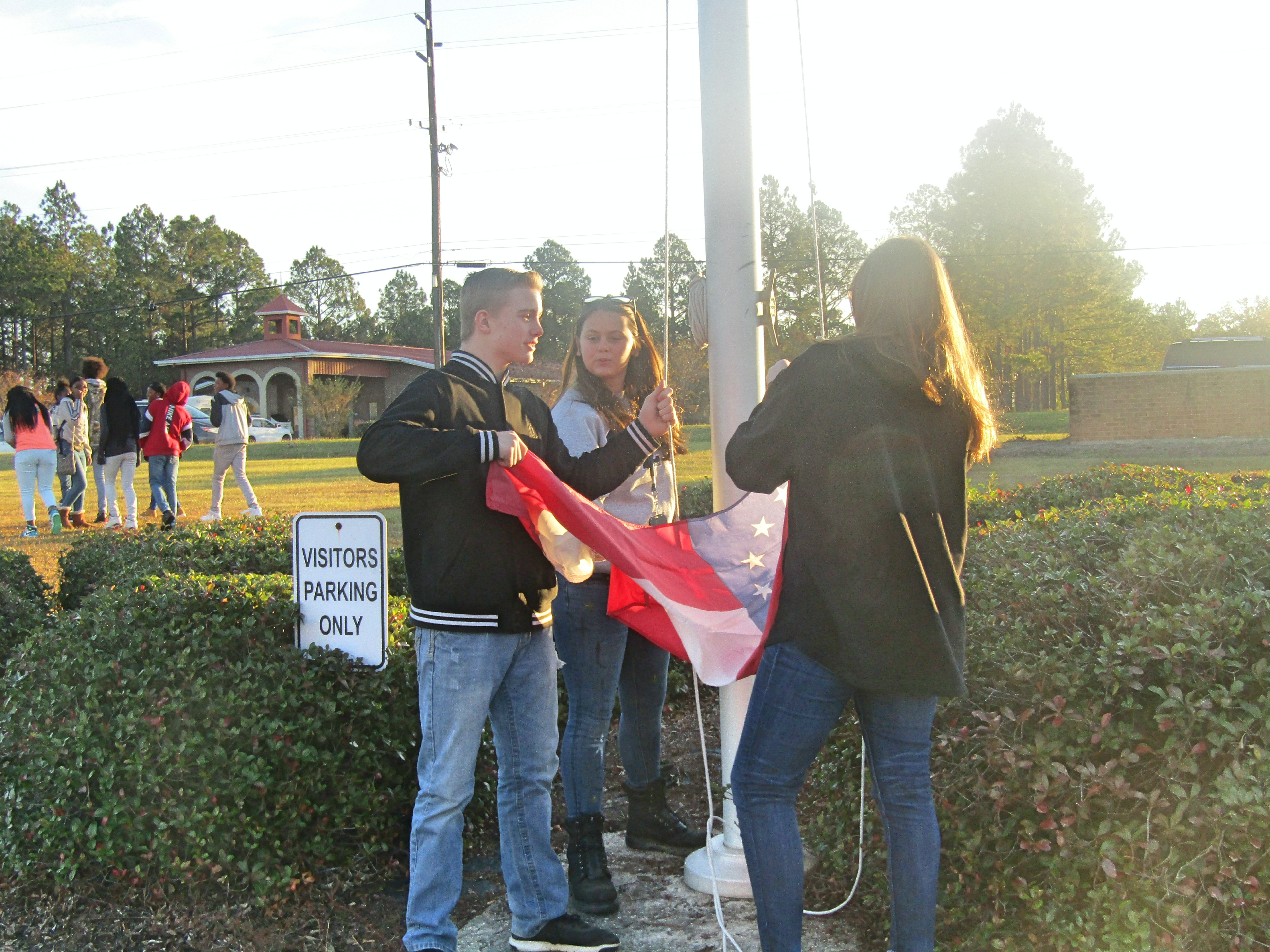 FCA - Prayer at the Pole - December Meeting - The flag goes up as students gather to pray.