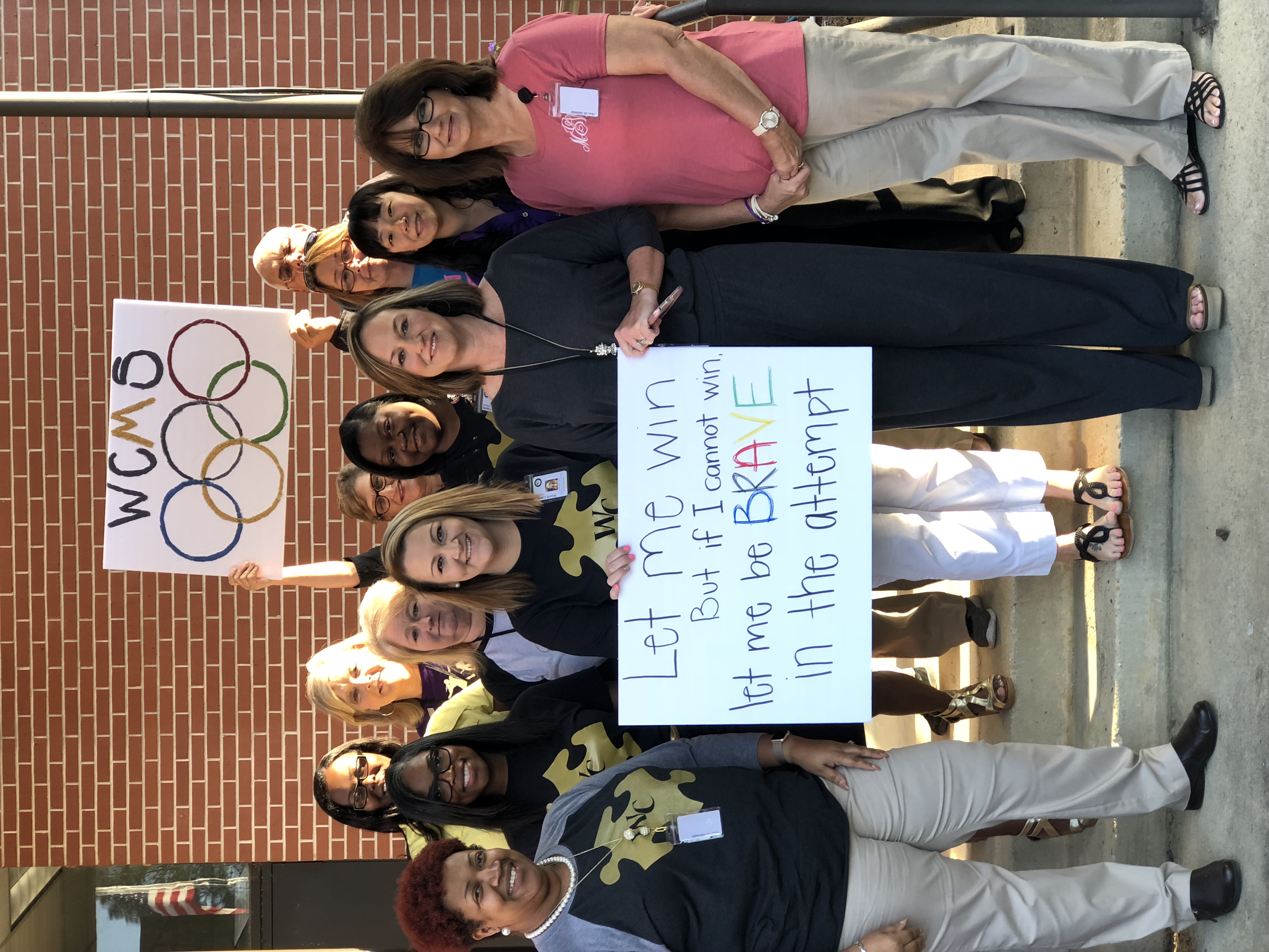 Special Olympics Send Off -Staff with signs